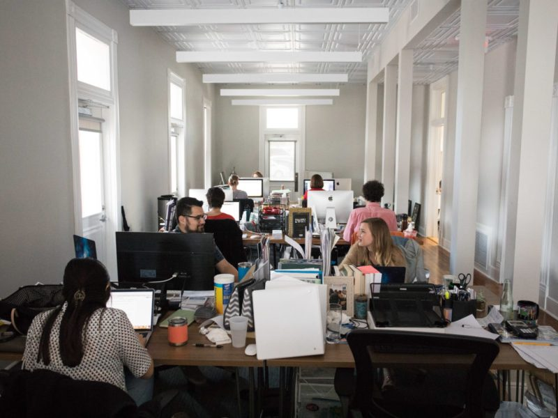 San Antonio Report staff works in their new office at 126 Gonzales St. in St. Paul Square.