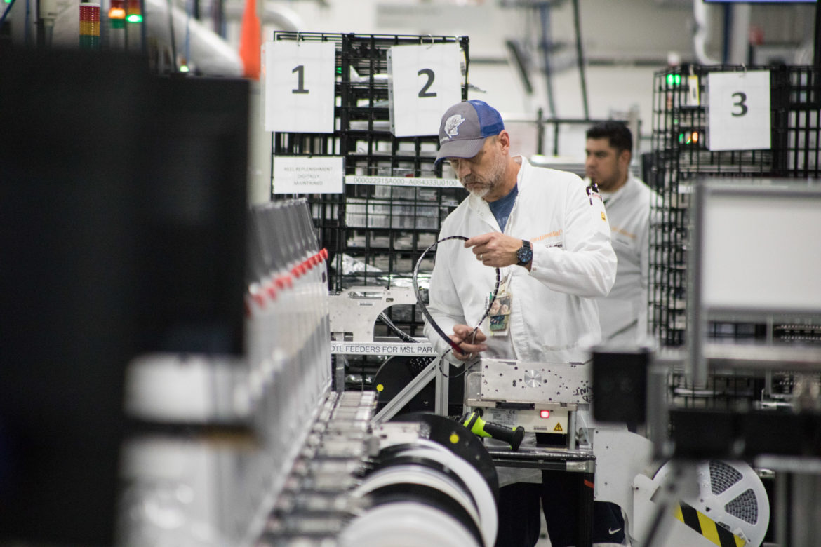 Continental Automotive Systems employees work on their line.
