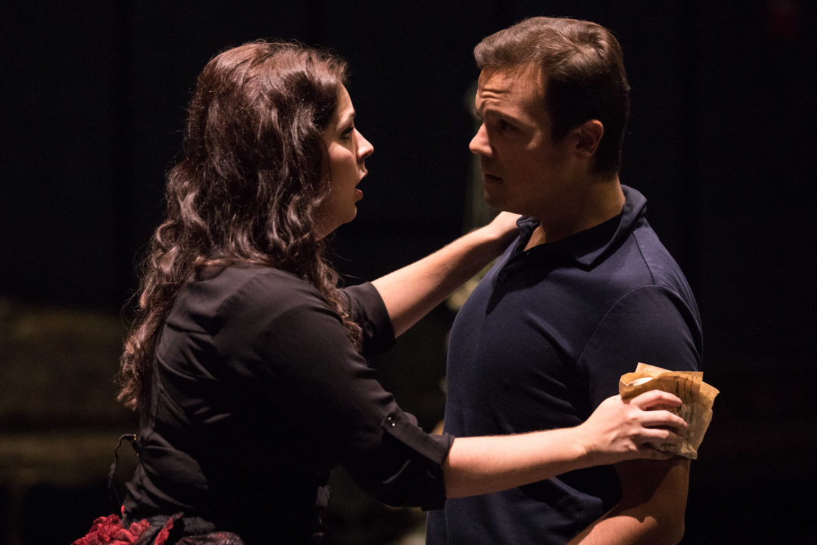 (From left) Violetta, performed by Amanda Woodbury, and Alfredo, performed by David Portillo, sing to one another.