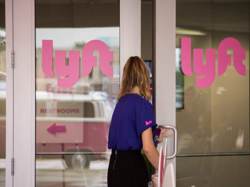 A Lyft employee enters the Driver Support Center.