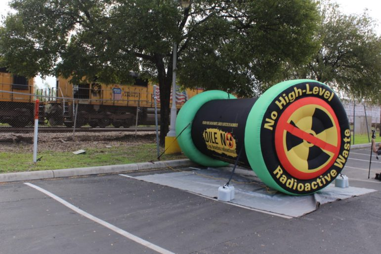 Anti-nuclear activists placed an inflatable mock nuclear waste storage cask near the rail line outside of the Alamodome on Wednesday, Sept. 26, during a press event regarding Waste Control Specialists' plan to store nuclear waste in West Texas.
