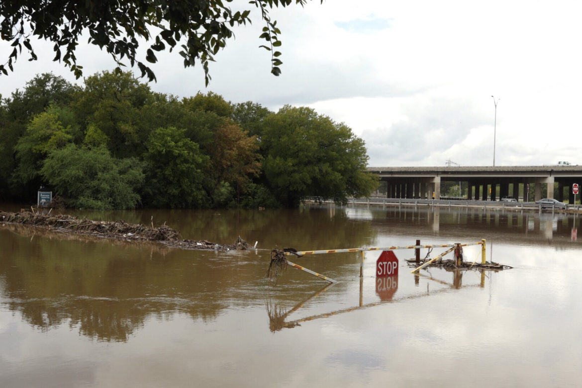 The entrance to Olmos Basin Park at East Basse Road is flooded following heavy rainfall throughout South Texas.