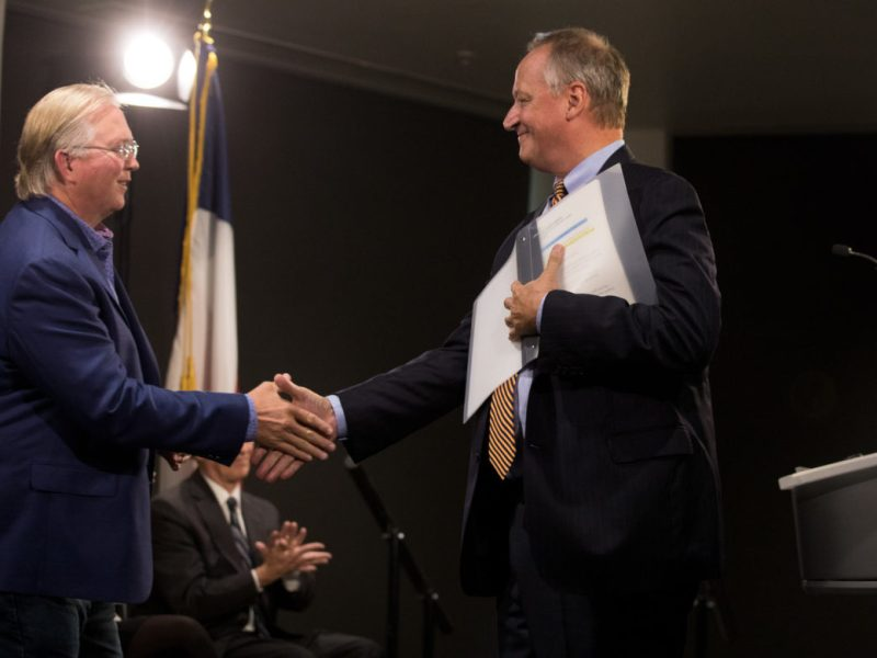 (From left) Graham Weston shakes hands with UTSA President Taylor Eighmy following the announcement of a $15 million gift in support of the UTSA downtown campus.