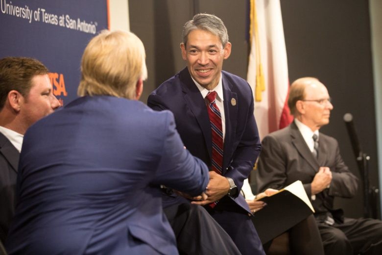 Mayor Ron Nirenberg shakes hands with business leader Graham Weston.