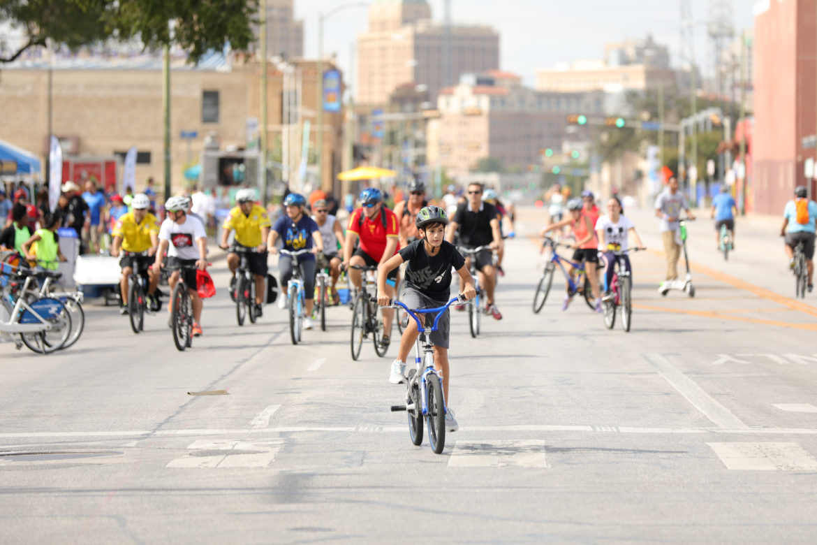 Cyclists take to a car-free Broadway street during Síclovía. The free event returns for 10th year.