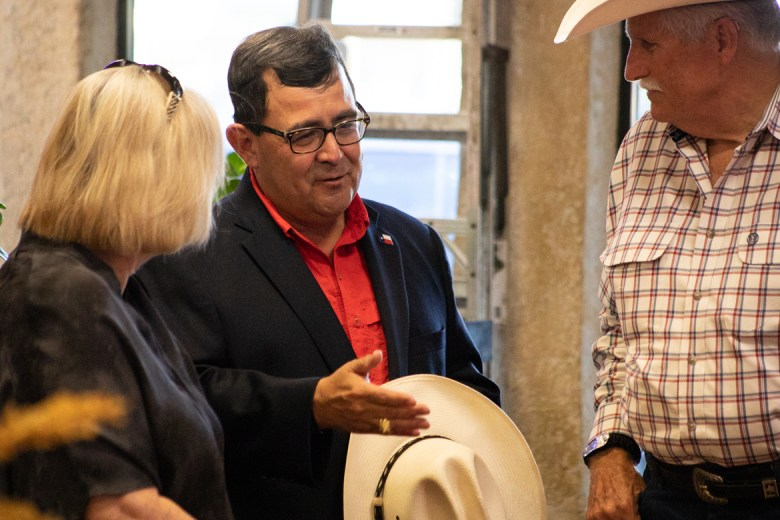 Republican Peter Flores, running for the Senate District 19 seat, (center) talks to his campaign supporters before early voting is completed at his watch party on September 18, 2018.