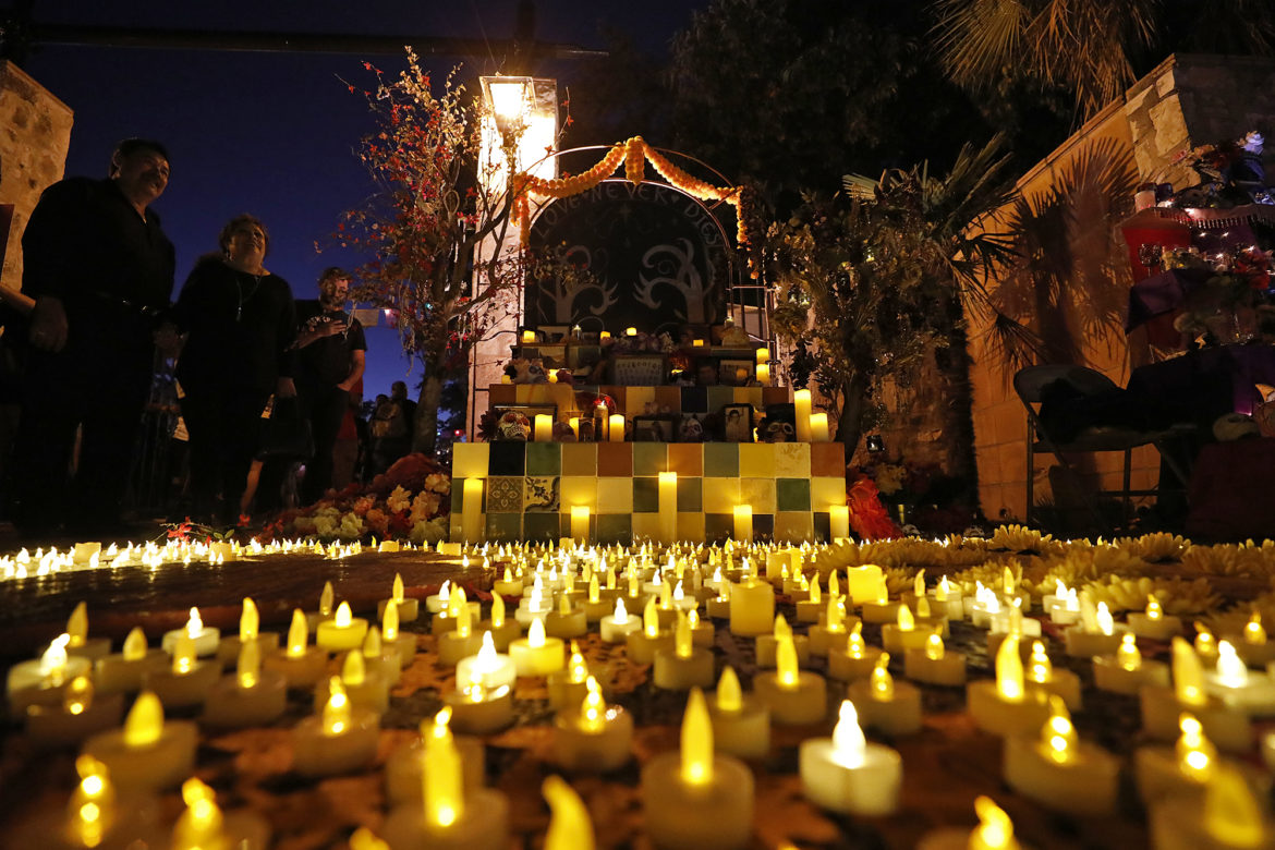 A family altar surrounded by illumination is displayed during the Dia de Los Muertos held at La Villita in 2018.