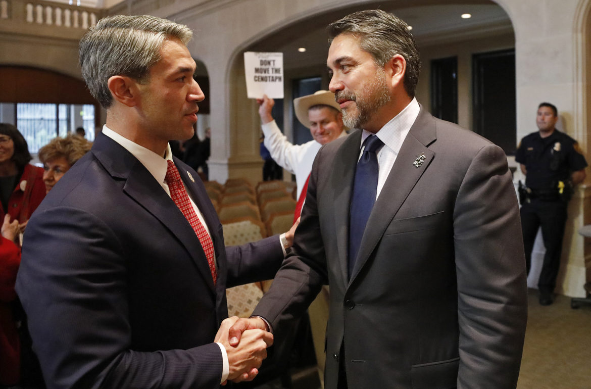 Mayor Ron Nirenberg (left) shakes hands with Councilman Roberto Treviño (D1) after the City Council approved the Alamo Redevelopment Plan in 2018.