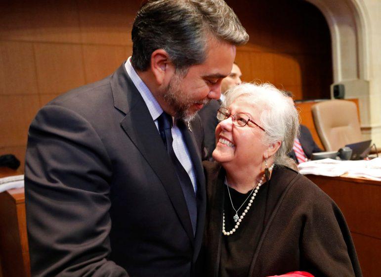 Councilman Roberto Treviño (D1) hugs his mother, Rosario Rincon after the City Council approved the Alamo redevelopment plan.