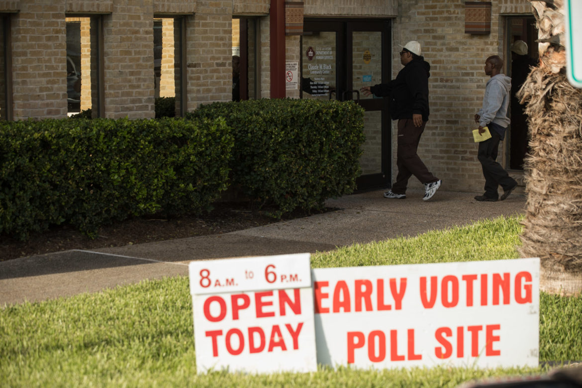 Voters walk into the Claude W. Black Community Center to cast their ballots.