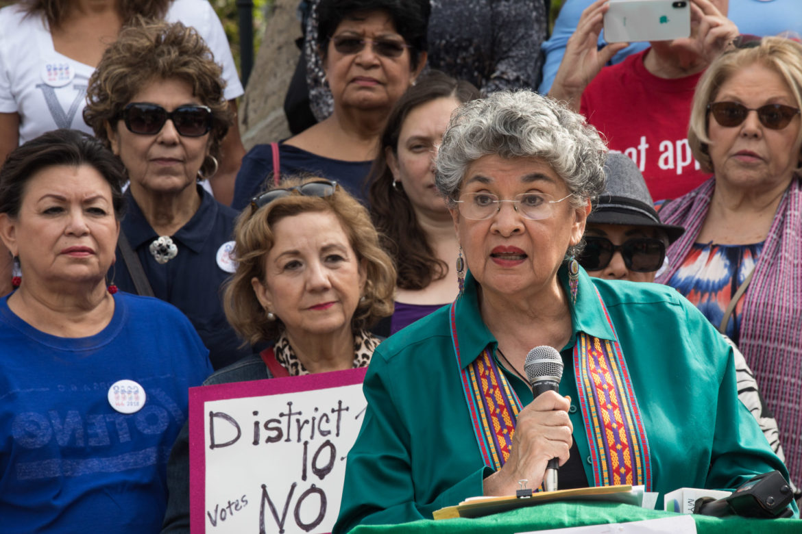 """Former City Councilwomen Maria Berriozábal introduces the group of Latinas and urges voters to vote """"no."""""""