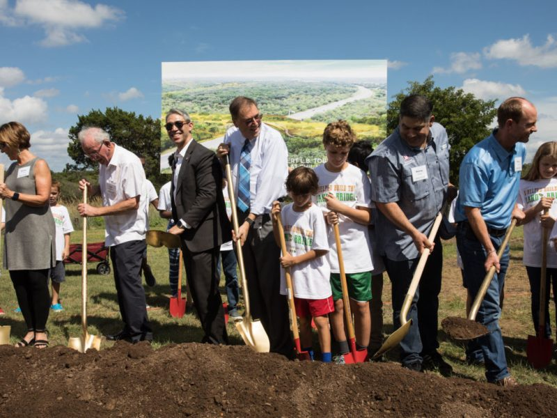 (From left) City Manager Sheryl Sculley, Phil Hardberger, Mayor Ron Nirenberg, Councilman John Courage (D9), Councilman Manny Pelaez (D8), and City Engineer and Director Mike Frisbie participate in the groundbreaking of the Robert L.B. Tobin Land Bridge at Phil Hardberger Park.