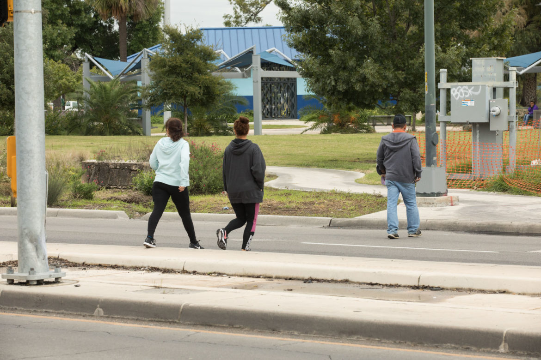 Pedestrians cross Commerce Street without a crosswalk on the westside.