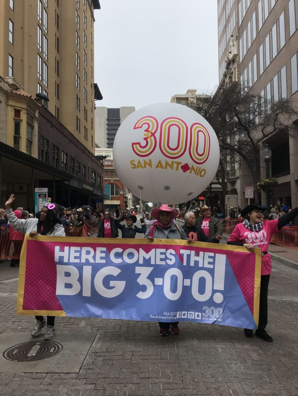 Serve 300 volunteers walk the Tricentennial balloon through a parade.