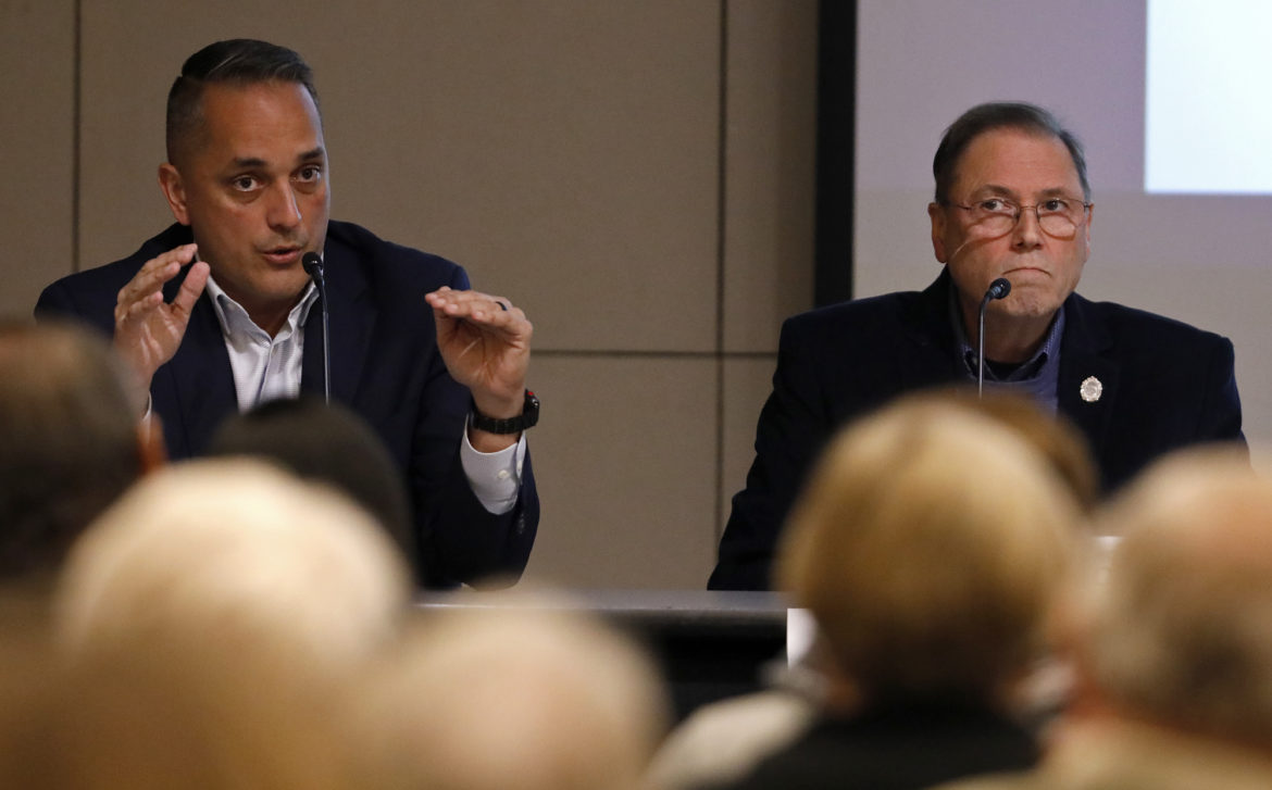 (From left) Councilman Greg Brockhouse (D6) speaks as Councilman John Courage (D9) listens during the League of Women Voters of the San Antonio Area forum on the Proposed Charter Amendments: Pros and Cons held Monday Oct. 15, 2018 at the Central Library.