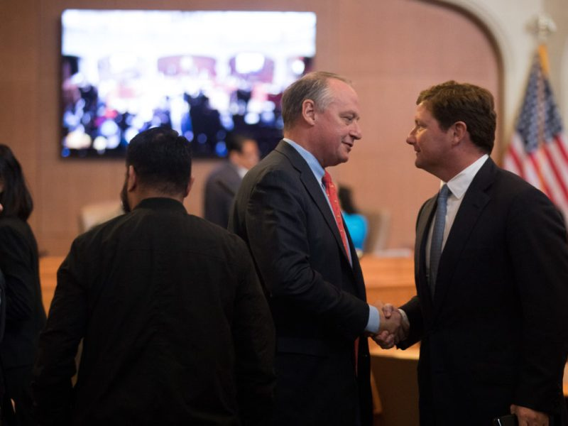 UTSA President Taylor Eighmy shakes hands with CEO of McCombs Partners and Immediate Past Chairman of the San Antonio Chamber of Commerce Rad Weaver following the approval of City Council.