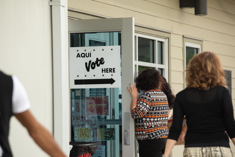 People walk into the William R. Sinkin Eco Centro to vote.
