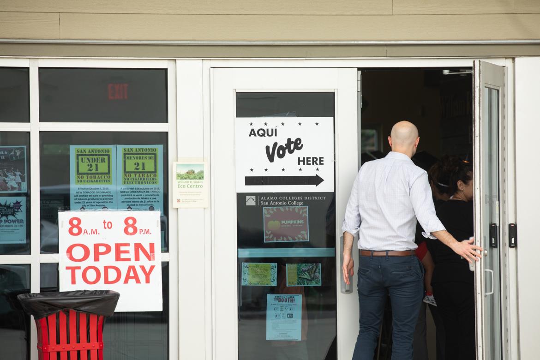 A man walks into the William R. Sinkin Eco Centro to vote.