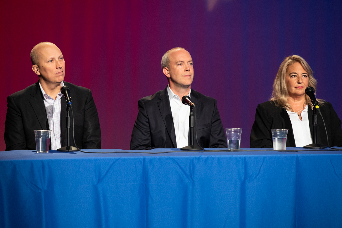 (From left) Candidates for House Seat District 21 Chip Roy, Joseph Kopser, and Lee Santos participate in a debate.