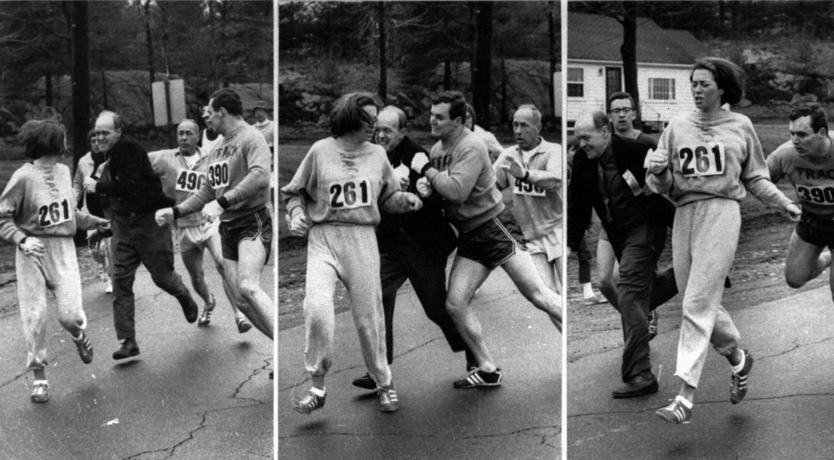 A woman, listed only as K. Switzer of Syracuse, found herself about to be thrown out of the normally all-male Boston Marathon when a husky companion, Thomas Miller of Syracuse, threw a block that tossed a race official out of the running instead, April 19, 1967 in Hopkinton, Massachusetts.