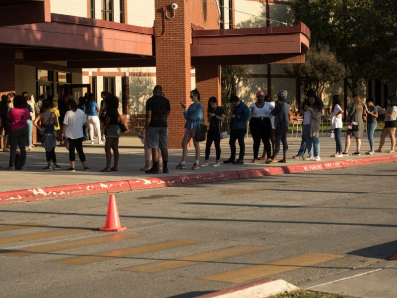 A long line of voters forms outside of Ed Rawlinson Middle School, a polling site.