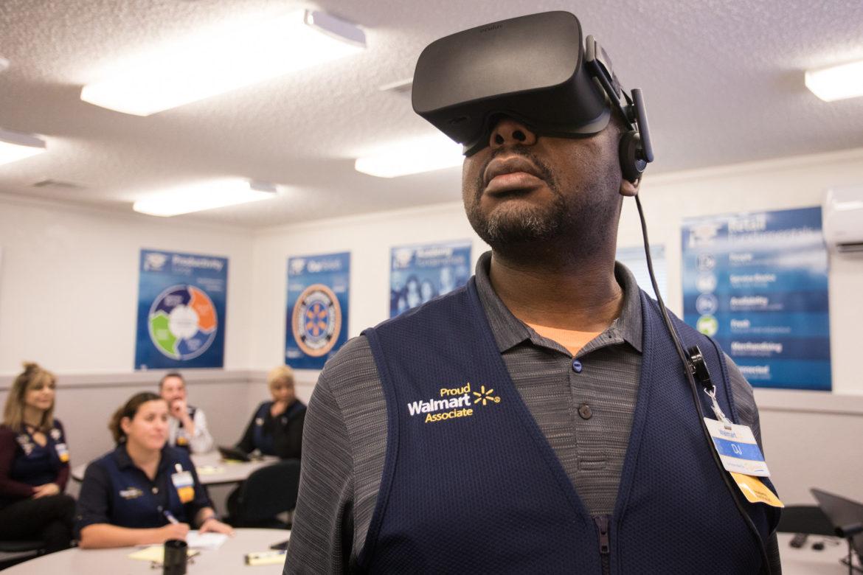 Walmart Academy Facilitator DJ Ddungu uses a VR headset to watch Walmart during the holidays.