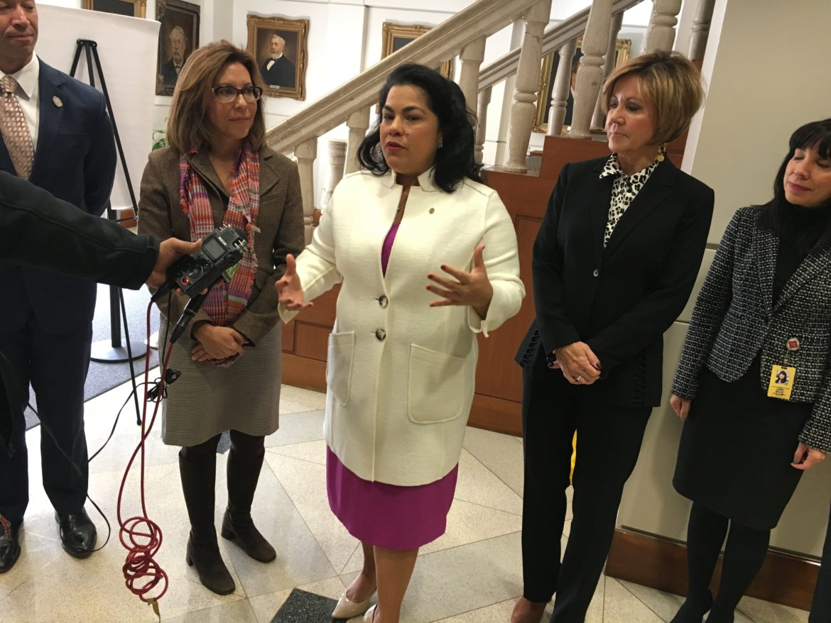 (center) Councilwoman Rebecca Viagran (D3) speaks to reporters following the passing of a resolution in support of women's equity.