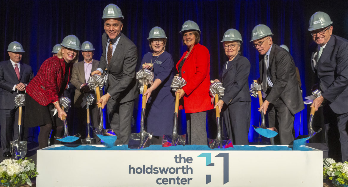 Holdsworth Center staff and supporters celebrate as they break ground on the upcoming think tank for public education leadership.