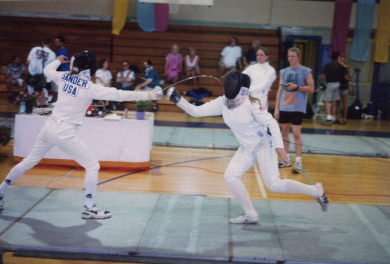 Sharon Sander is photographed as she gets a touch against an opponent in a fencing competition.