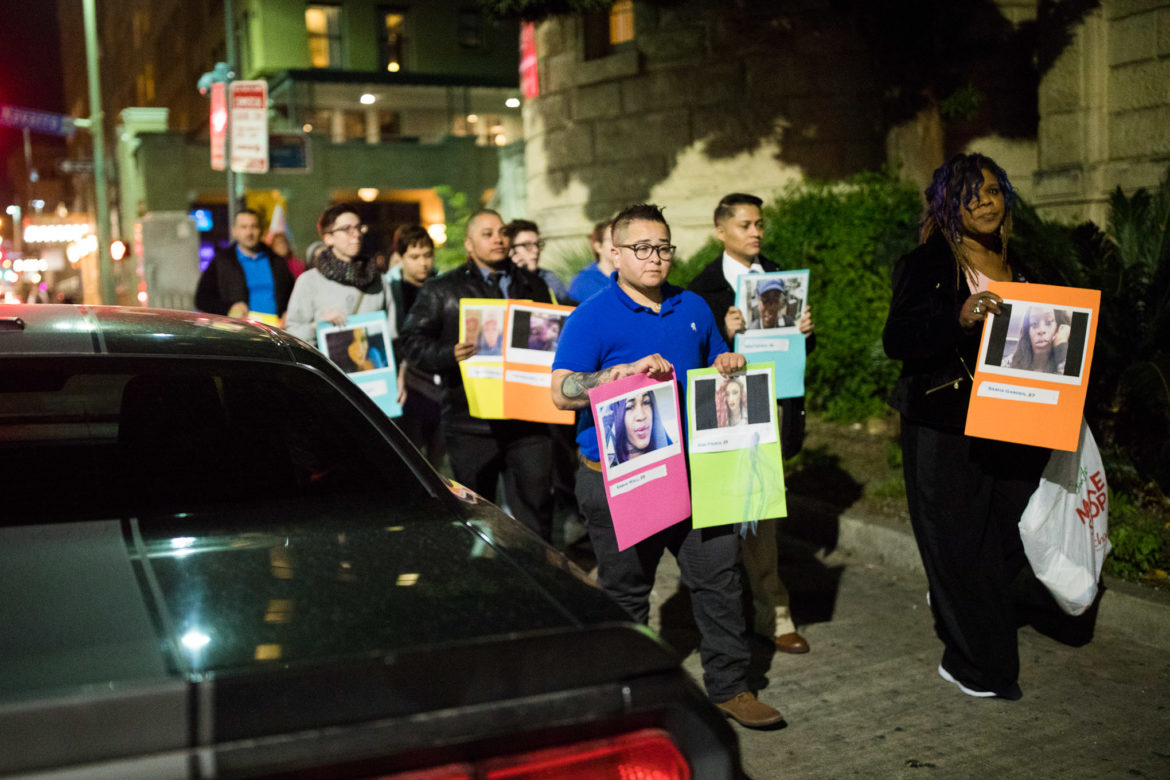 LGBTQ+ supporters carry photographs of passed trans members to Travis Park Methodist Church for Transgender Day of Remembrance.