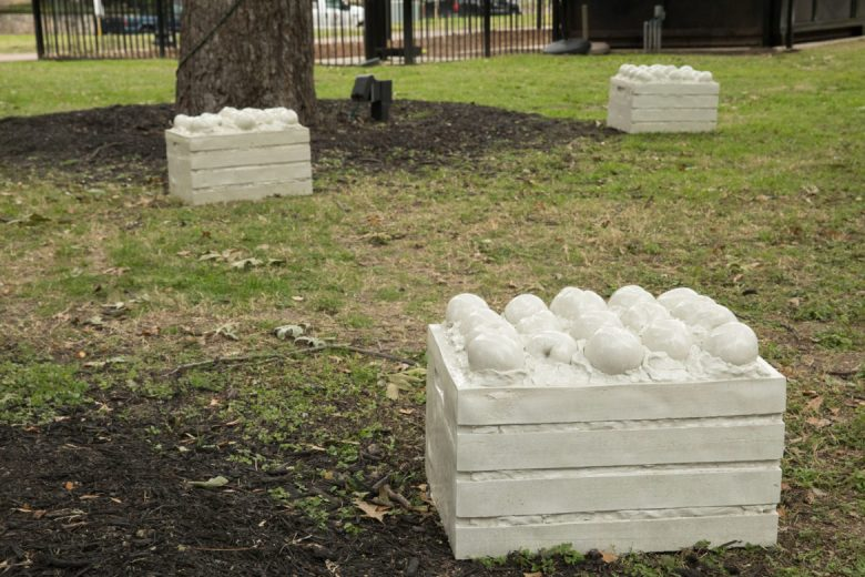 An installation of concrete peach crates for Travis Park: First Fruits
