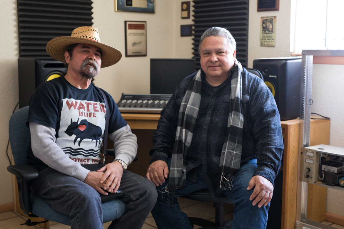 (From left) Juan and Armando Tejeda sit for a portrait at KEDA Radio.