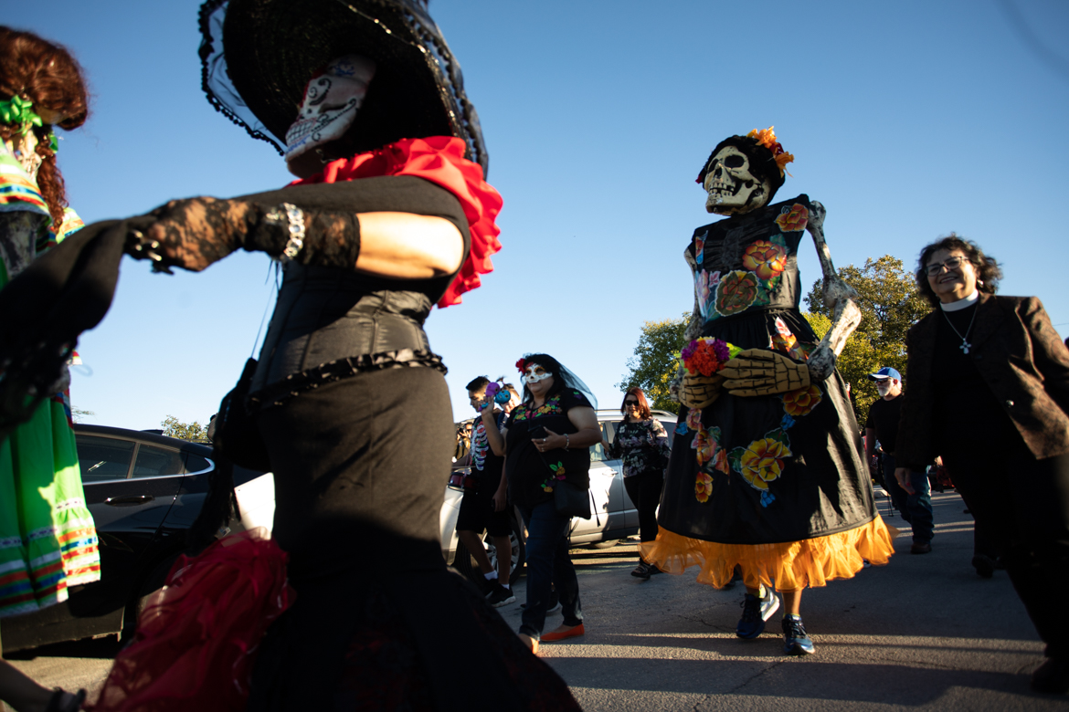 Many people dress in costume for the procession during the Día de los Muertos celebration at the Rinconcito de Esperanza.