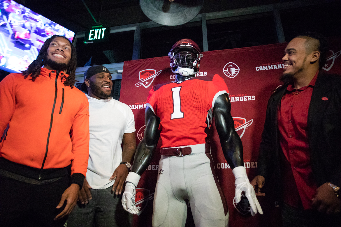 San Antonio Commanders players unveil a statue dressed in the football team's new uniform Tuesday night.