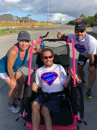 Stephanie Kemp (left) and Rob Kemp (right) push people in wheelchairs through races numerous times each year as part of larger groups.