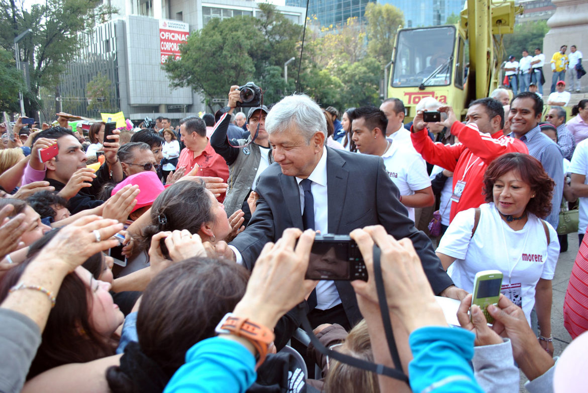 Andres Manuel Lopez Obrador greets attendees during a rally at the Angel of Independence.