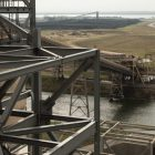 A pile of coal (top center) lies in the distance at Calaveras Power Station, viewed from CPS Energy's Deely plant.