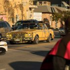 """A car featured in the film """"Machete"""" rides in the procession."""