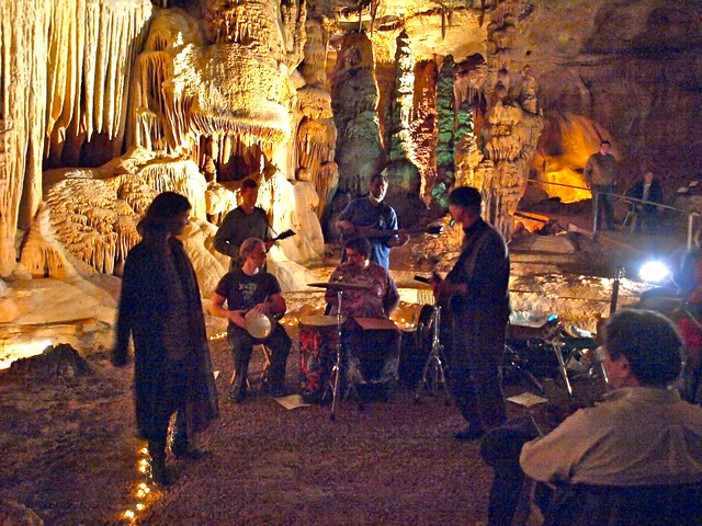 Musicians play during a past performance in a Cave Without a Name.