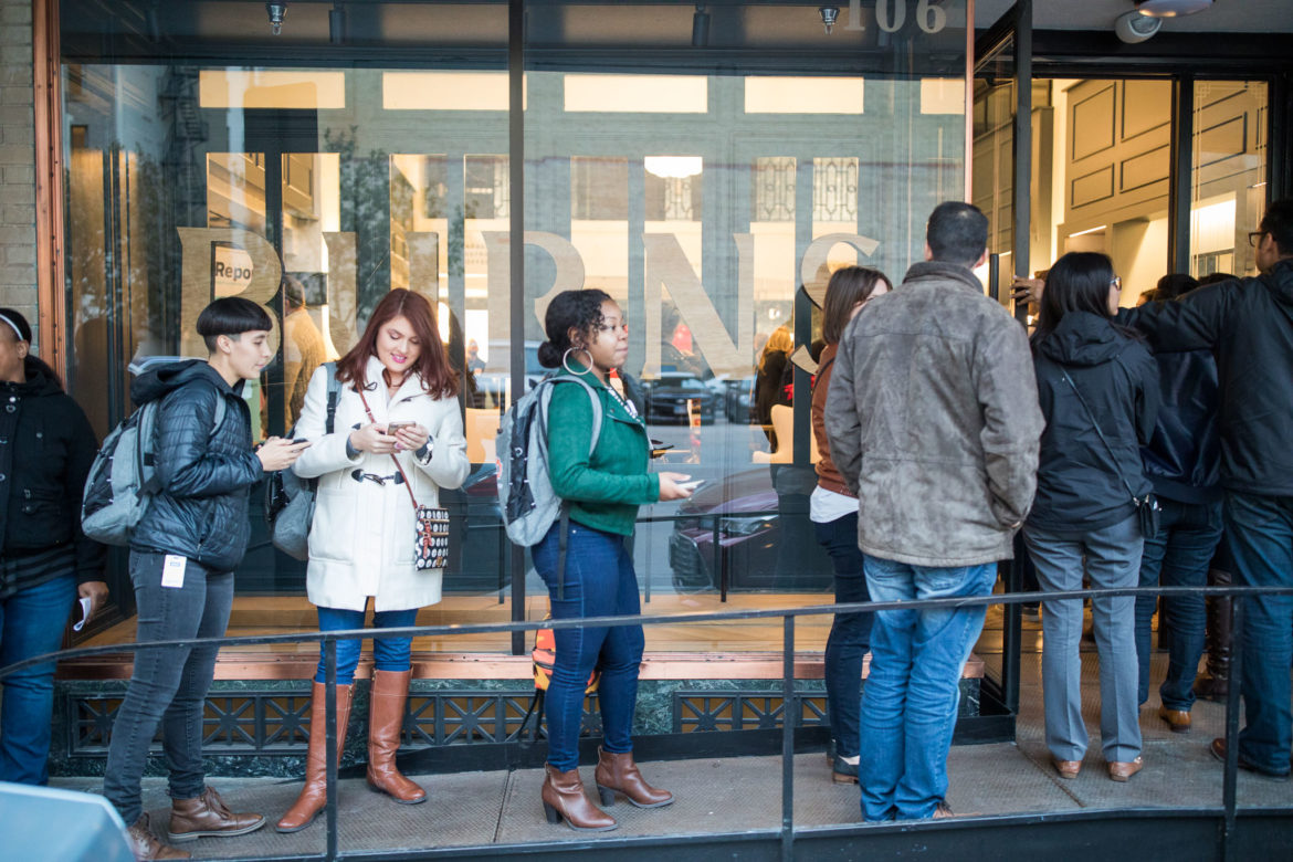 Guests wait in line to enter the Burns Building during the TechBloc holiday party.