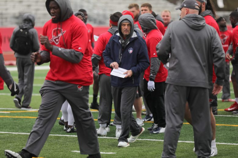 San Antonio Commanders Head Coach Mike Riley runs drills with his players during a practice.