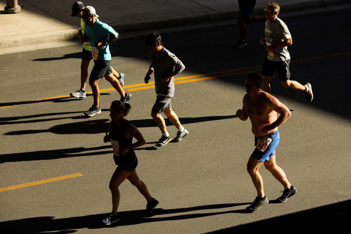 Runners cross under US HWY 281 during the Rock 'n' Roll marathon.
