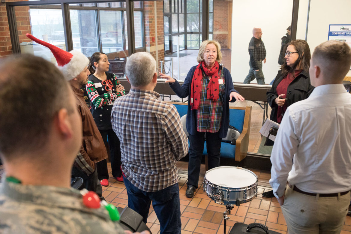 Allyson Dawkins, principal violist, gives musicians instructions to members of the San Antonio Symphony, the U.S. Air Force Band of the West, and the University of Texas at San Antonio, before performing in the Bexar County Jail.