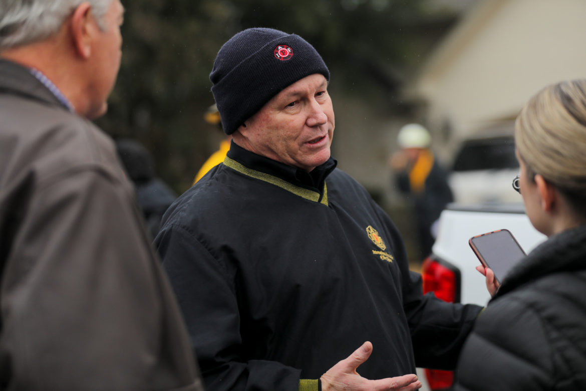 Veteran firefighter Rick Swan speaks to reporters about the risks of fast moving wildfires.