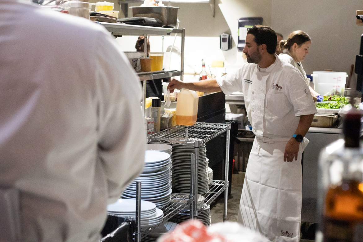 Chef Juan Carlos Gonzales works in the kitchen while the hors d'oeuvres are served.