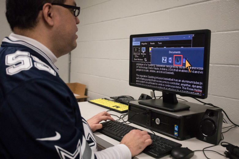 Michael Guajardo, supervisor for the assistive technology department at the Lighthouse, demonstrates how to use a computer while visually impaired.