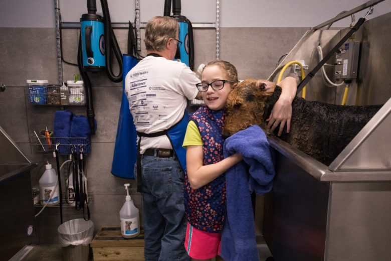 Emma, 10, and Dennis Reaser prepare to give their dog Rowdy a bath.