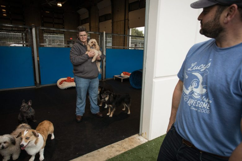 Owner Max Golman (right) looks around the small dog area as Lynette Gibson holds a pup.