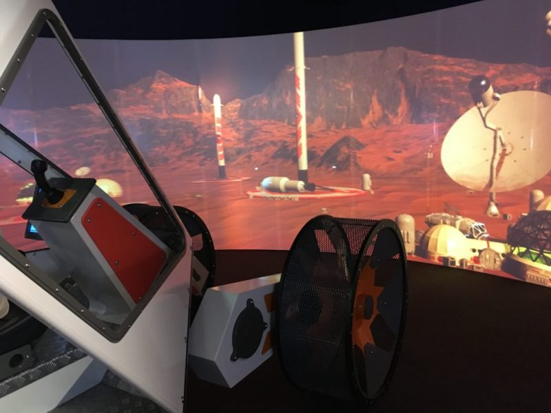 """A life-size rover allows visitors to """"drive"""" through a virtual human settlement on Mars."""
