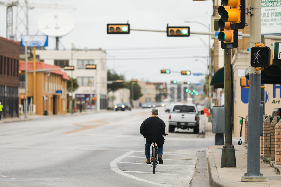 Broadway begins to narrow heading South at Pecan where pedestrians, auto vehicles, and electric vehicles converge.